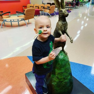 Aiden begged his mom to take a picture as he posed in front of this statue at Phoenix Children's Hospital.