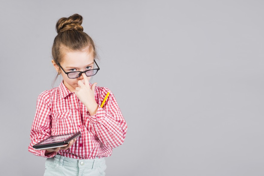cute-girl-glasses-standing-with-tablet